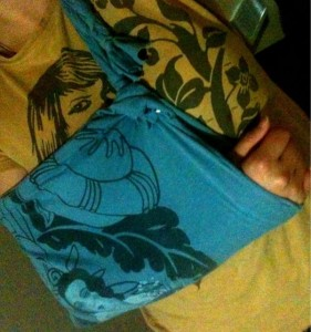 A sling made with a t-shirt, staples, braids, and knots