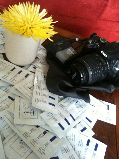 50 hcg test strips, a spider mum, and a camera